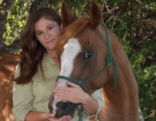 Equine Massage Therapist, Web Designer & Photographer, Lisa Carter with her Arabian mare Siofhice