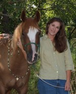 Lisa Carter, Certified Equine Massage Therapist, with her Arabian mare Siofhice. www.heavenlygaitsequinemassage.com.