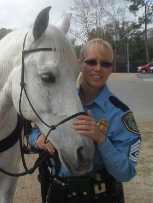 Sergeant Leslie Wills of the Houston Police Department Mounted Patrol & her partner Nacho, a rehabilitated Iberian Warmblood